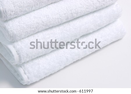 White towels over a white background. - stock photo
