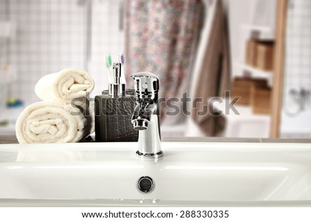 white towels soap and sink in bathroom  - stock photo