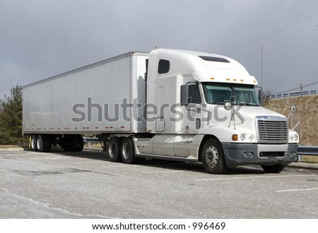 White Tractor Trailer Semi Truck - stock photo