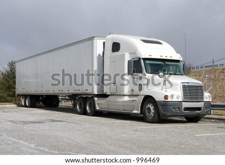 White Tractor Trailer Semi Truck - stock photo