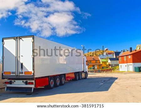 White trailer on the street of norwegian village - stock photo