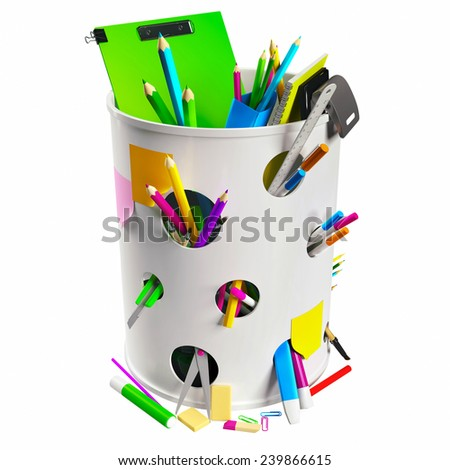 White trash can with circle holes filled with some office stationery - stock photo