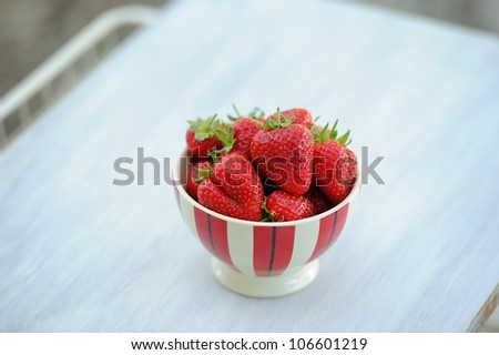 White tray with plate of fresh strawberries in Provence, France - stock photo