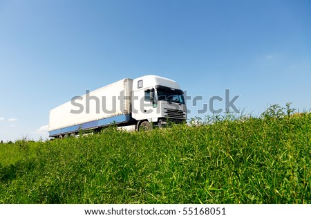 White truck driving on the road - stock photo