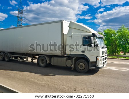 White truck on a highway - stock photo