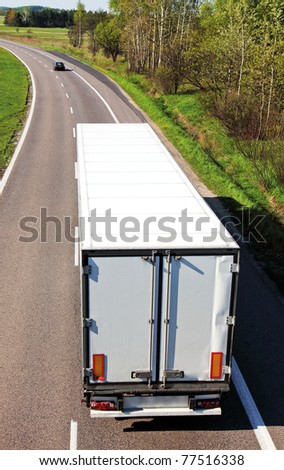 White truck on asphalt road - stock photo