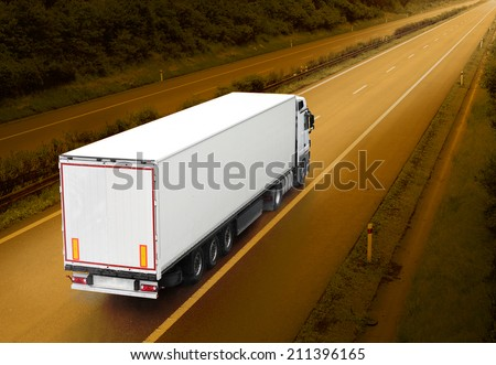 White truck on the highway. Picture with space for your text. - stock photo