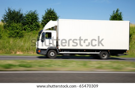 White truck speed - stock photo