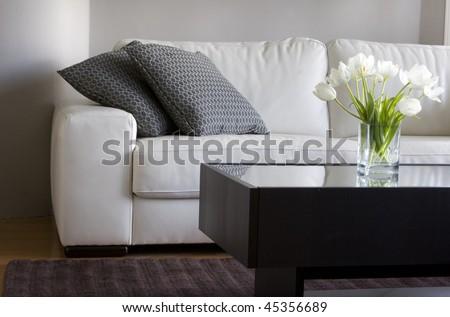 white tulips in modern living room - stock photo