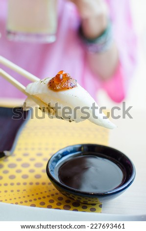 White tuna sushi and salmon roe with chopstick - stock photo