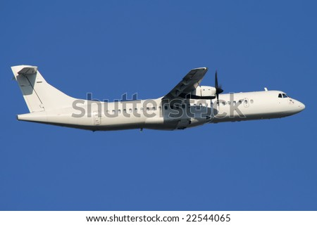 White turbo-prop airplane is climbing after take-off - stock photo