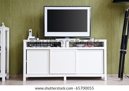 White TV-set in modern stylish home interior - stock photo