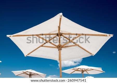 white umbrella blue sky - stock photo
