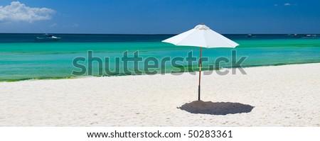 White umbrella on perfect tropical beach in Boracay, Philippines - stock photo