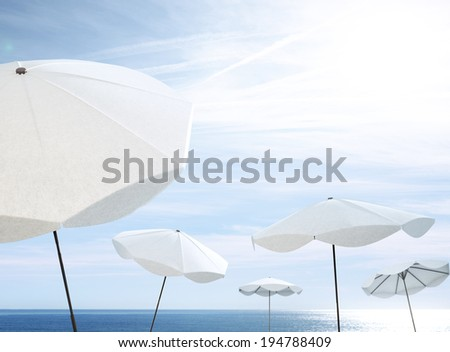 white umbrellas on the beach - stock photo