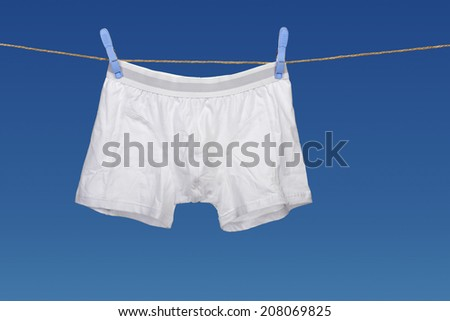 white underwear on a string against clear blue sky - stock photo