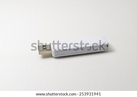 White USB pendrive. Shoot over white background. Focus on the closes distance. Shallow depth of field.