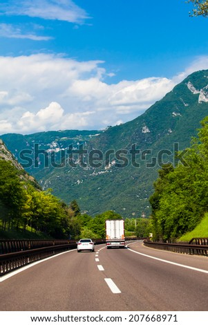 white van on highway. Camper on the road. camping car - stock photo