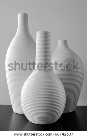 White Vases on a black countertop
