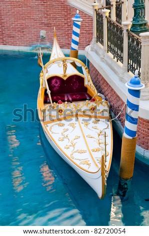 White venetian gondola in Las Vegas casino, USA on blue water - stock photo
