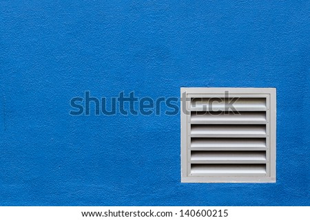 White Vent on Blue Concrete Wall - stock photo