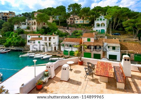White villas and terrace in gulf of Cala Figuera, Mallorca, Spain - stock photo