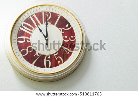 white vintage clock on the wall
