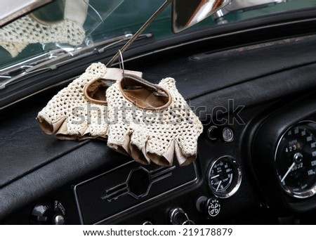white vintage perforated leather gloves for the vintage car race - stock photo