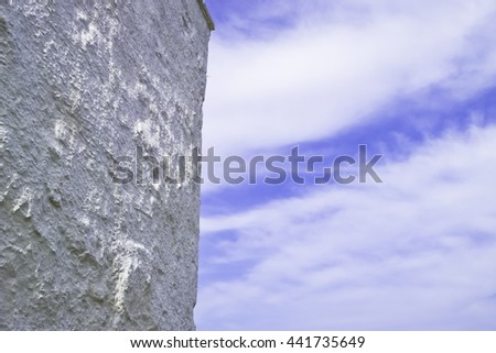 White wall and cloudy sky.
