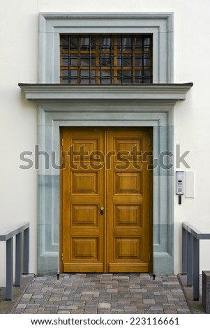 White wall and new yellow wooden door urban details background