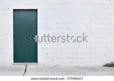 white wall dark green door - stock photo