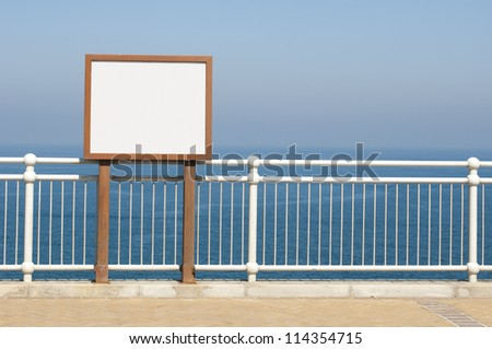 White wall for messaging and sea on the background - stock photo