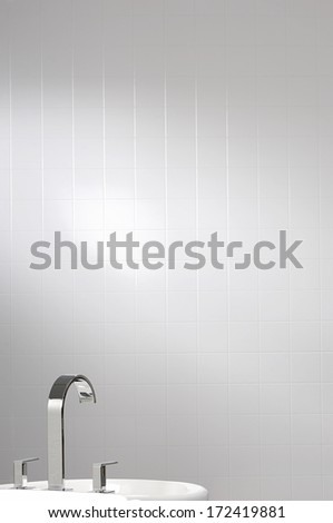 white wall tile with faucet and sink - stock photo