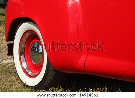 White Wall Tire on Antique Red Car - stock photo