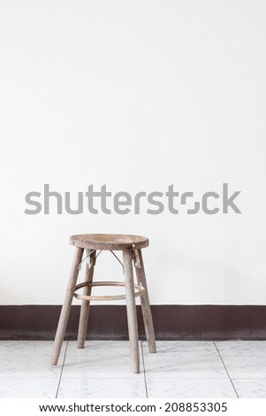 White Wall with Chair - stock photo