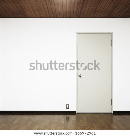 white wall with door - stock photo