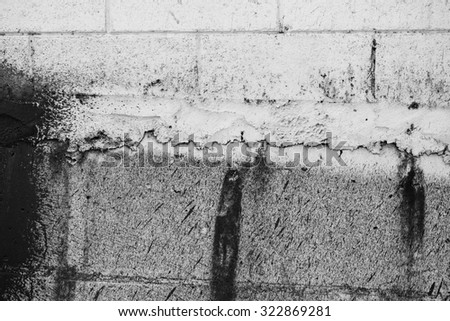 White wall with gray and black stains - stock photo