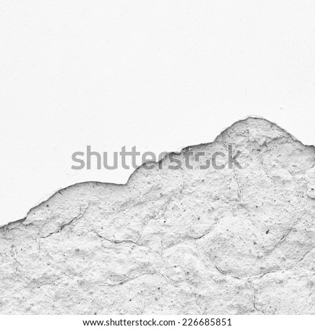 White wall with half of the plaster fallen off - stock photo