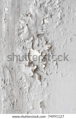 White wall with painting falling apart - stock photo
