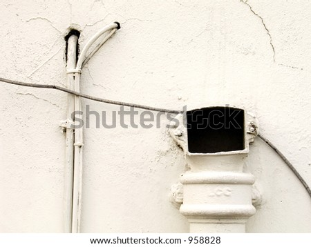 White wall with pipes - stock photo