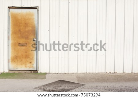 white wall with rusty door - stock photo