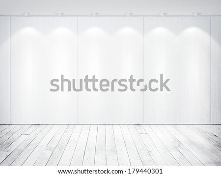 White wall with spotlights. White wood floor. - stock photo