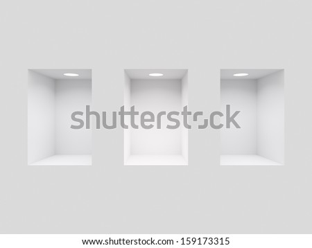 White wall with three lit niches - stock photo