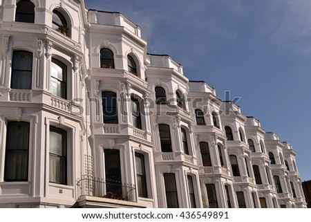 White washed terraced georgian Notting Hill houses with apartments. Notting Hill London 2015 London georgian apartments building - stock photo