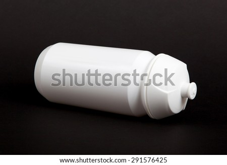 White water bottle isolated on black background