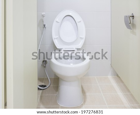 White water closet in toilet.