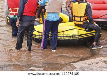 White water rafting on the rapids of river - stock photo