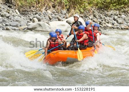 White water rafting team in bright sunlight, Pastaza river, Ecuador, Sangay National Park. - stock photo