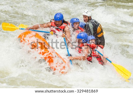 White Water Rafting Team In Bright Sunlight Pastaza River Ecuador Sangay National Park - stock photo
