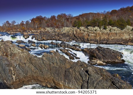 White water river and rocks in autumn - stock photo